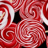 Peppermint Twist - Tossed Peppermint Lollipops on Black