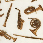 Tossed Brass and Woodwind Musical Instruments on Cream