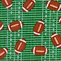Small Scale Footballs on Green Field