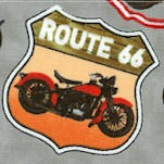 Route 66 - Tossed Vintage Motorcycles and Road Signs on Gray